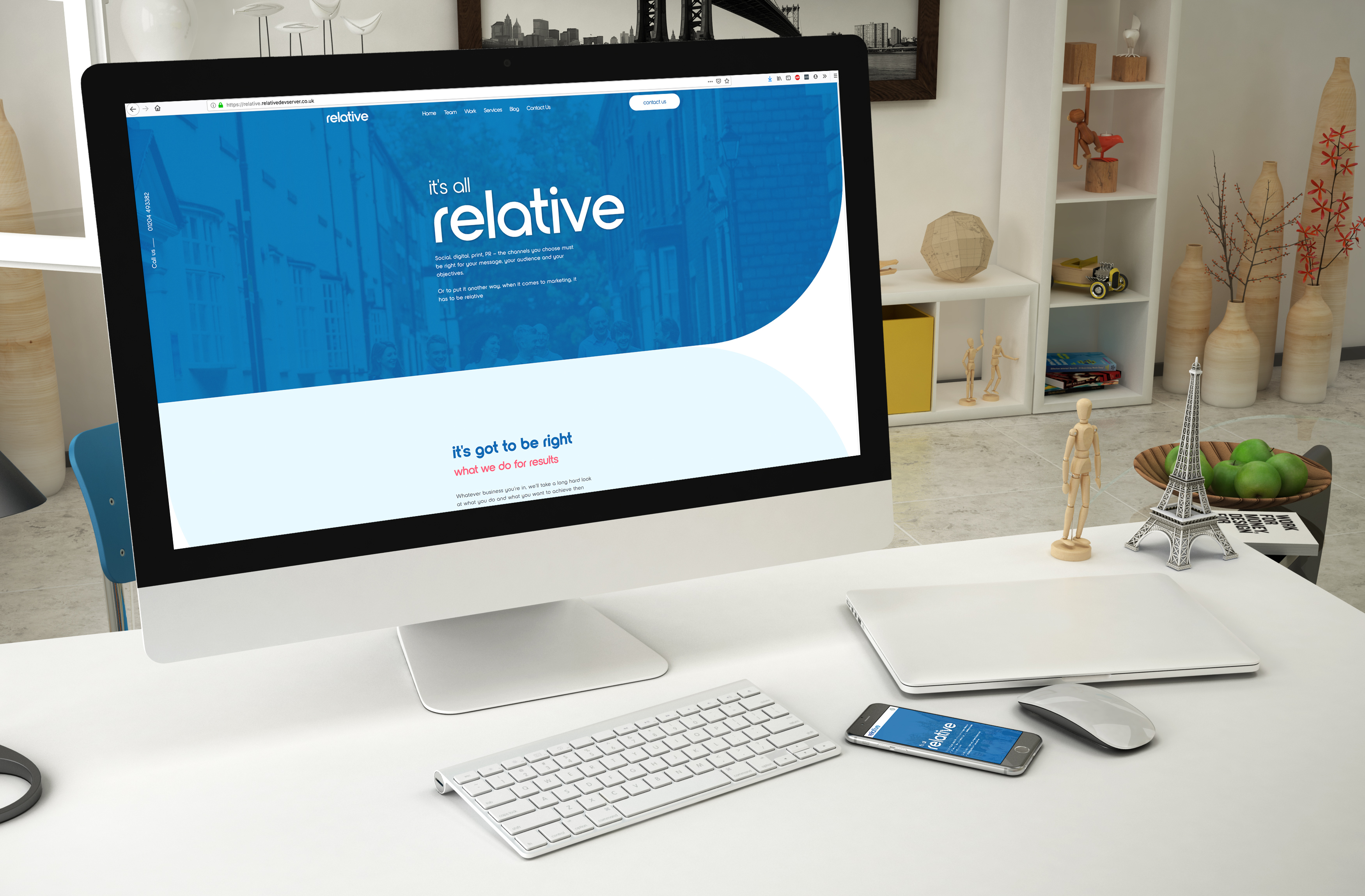 relative marketing website on an apple mac in a living room