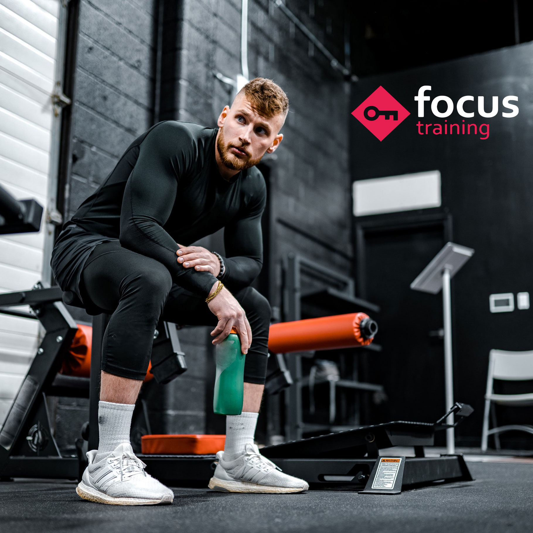man in gym with focus logo in the corner